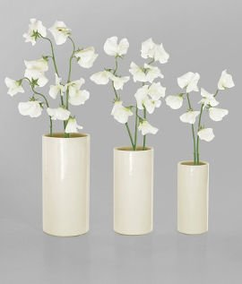 3 white vases with white flowers by RALLI Design