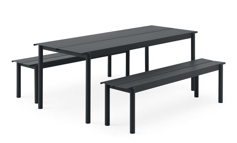 Black Linear Outdoor Table and Benches by Muuto on white background