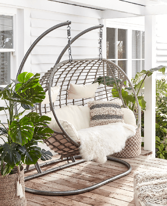 Cox and Cox Double Indoor Outdoor Hanging Chair with cream cushions