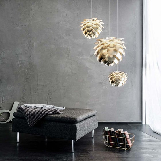 Cluster of small and large Silvia light shades in brass with grey wall in contemporary living room