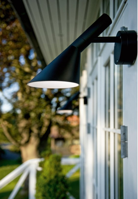 Louis Poulsen AJ50 LED Outdoor Lamp in black on contemporary building
